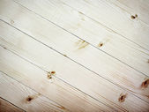 Diagonal wooden planks texture with branch — Stock Photo