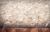 Compressed wood and brick grunge wall — Stockfoto