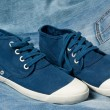 Stock Photo: Pair of new blue shoes on jeans