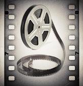 Carrete de película película vieja con la tira de película. fondo vintage — Foto de Stock