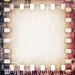 Grunge scratched film strip background — Stock Photo