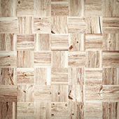 Wooden mosaic background made of old planks — Stock Photo