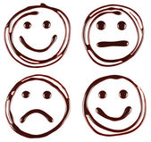 Set of smiley faces made of chocolate syrup are on white background — Stock Photo