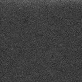 Black sandpaper background — Stock Photo