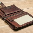 Opened old purse on wooden table — Stock Photo #44023427