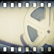 Old motion picture reel with film strip. — Stock Photo