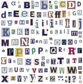 Alphabet letters made of newspaper and magazine — Stock Photo