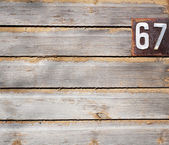Old grungy wooden wall with house numbers — Stock fotografie
