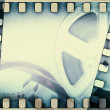 Old motion picture film reel with film strip. Vintage background — Stock Photo