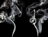 Grey smokes on black background — Stock Photo
