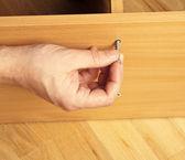 Carpenter mounting wooden furniture — Stock Photo