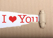 I love you text on paper and torn cardbox — Stock Photo