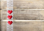 Red hearts on old wooden background — Stock Photo