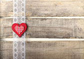 Red heart on old wooden background — Stock Photo