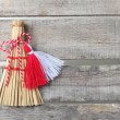 Red and white martenitsa on old wooden background — Stock Photo #41640905
