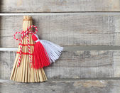 Red and white martenitsa on old wooden background — Stock Photo