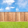 Stock Photo: Wooden fence at grass