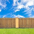 Stock Photo: Traditional brown pine wooden fence