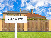 House for sale behind the fence — Stock Photo