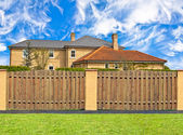 House behind the fence with the skies — Stock Photo