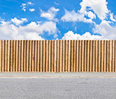Half round post and rail fence with skies and gravel road horizontal seamless — Stok fotoğraf
