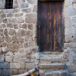 Stock Photo: Mediterranewood door and stone wall, Corsica, mountain v