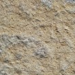 Weathered white tuff stone from a cathedral - Stock Photo
