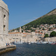 Stock Photo: Dubrovnik, august 2013, footpath at harbor entrance