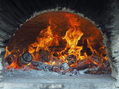 Wood fire in a bread oven — Stock Photo