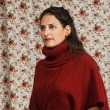 Woman in red over floral background — Stock Photo #12770663