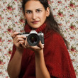 Woman in red over floral background — Stock Photo #12770683