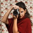 Woman in red over floral background — Stock Photo #12770722