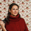 Woman in red over floral background — Stock Photo