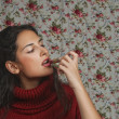 Woman with lipstick with floral background — Stock Photo #12770797