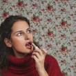 Woman with lipstick with floral background — Stock Photo #12770830