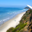 Southern California surfing beach with surfboard in the foregrou — Stock Photo