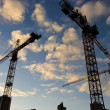 Stock Photo: Wide angle view of a construction site with many cranes
