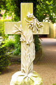 Stone cross with floral motive on a graveyard — Stock Photo