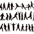 Stockvector : Kid silhouettes playing football