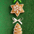 图库照片: Christmas Ginger cookies on green background