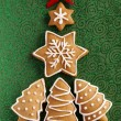 Christmas Ginger cookies on the green texturized background — Stock Photo #13472823