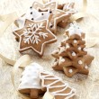 Foto Stock: Christmas background with Ginger cookies and gold ribbons.