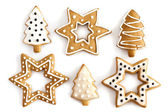 Gember kerstkoekjes op geïsoleerde witte achtergrond — Stockfoto