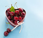 Sweet Cherries in the heart shaped box for Valentine — Stock Photo