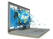 Earth globe coming out from a laptop computer — Stock Photo