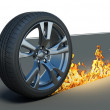 Car wheel and track fire on the road — Stock Photo #49063351