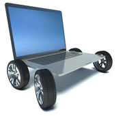 Modern laptop with car wheels on a white background — Stock Photo