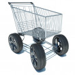 Shopping basket on the road wheels. The concept of large purchas — Stock Photo #51211085