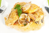 Fish with seafood sauce — Stock Photo