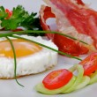 Fried Eggs Sunny Side Up with greens and bacon — Stock Photo #11456293
